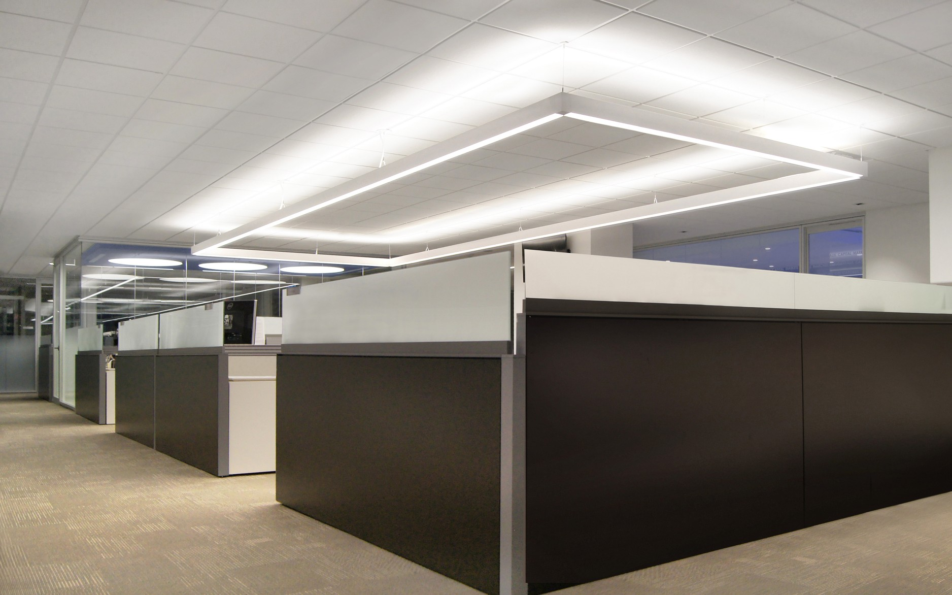 The firm used suspended Lumenline Pendants over main work areas, creating bright, lively zones.