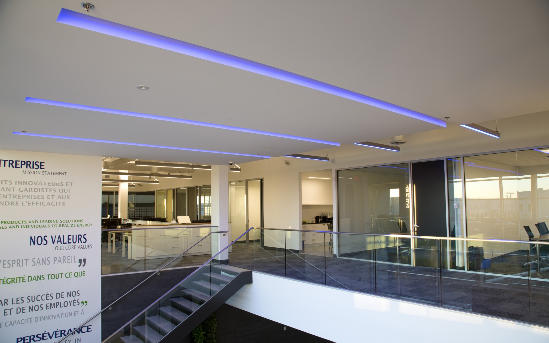 The Lumenline RGB luminaires are mounted in slots in the ceiling, emerging as pendants at the end.