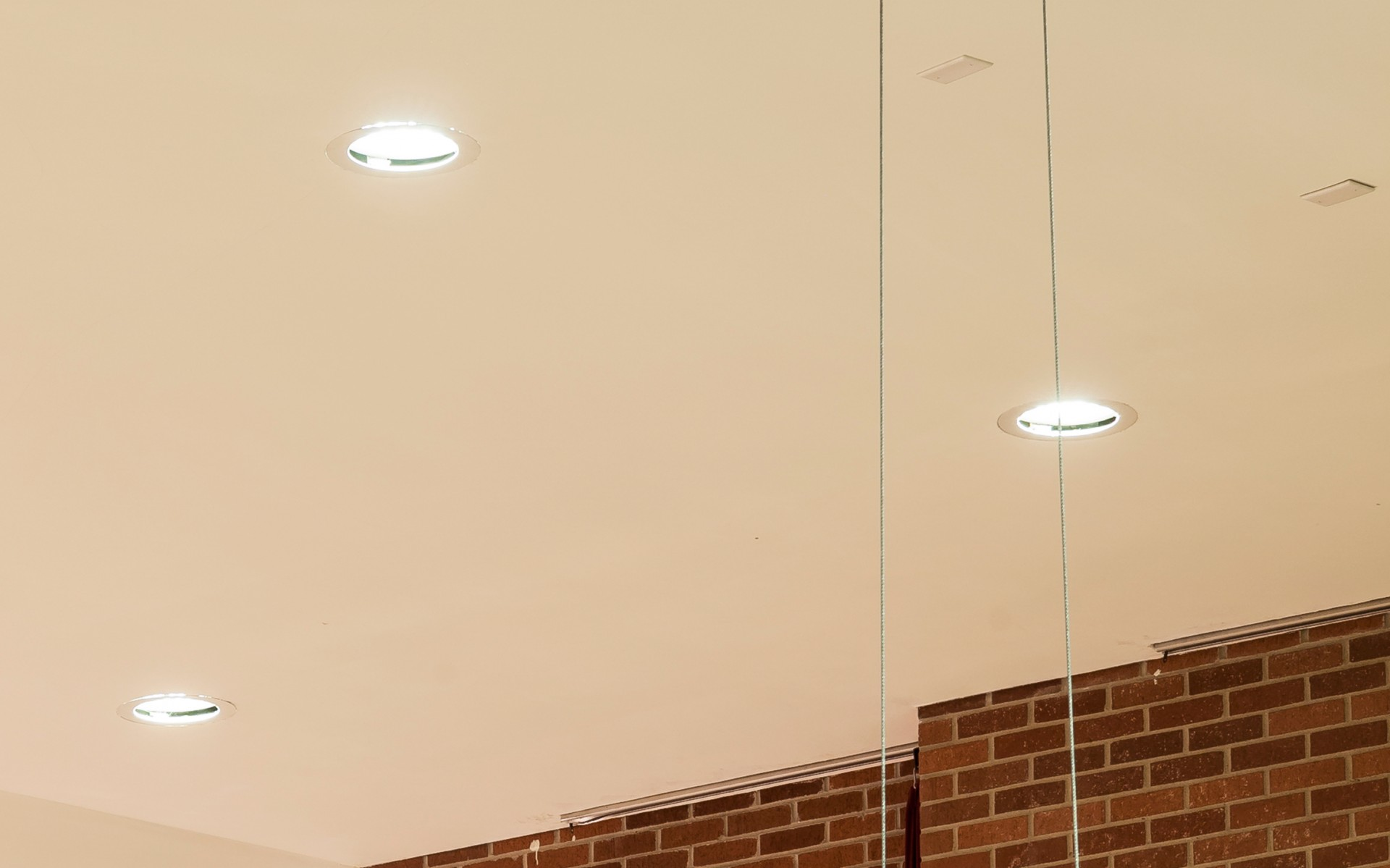 To limit renovation work, new LED luminaires had to fit existing holes in the ceiling.