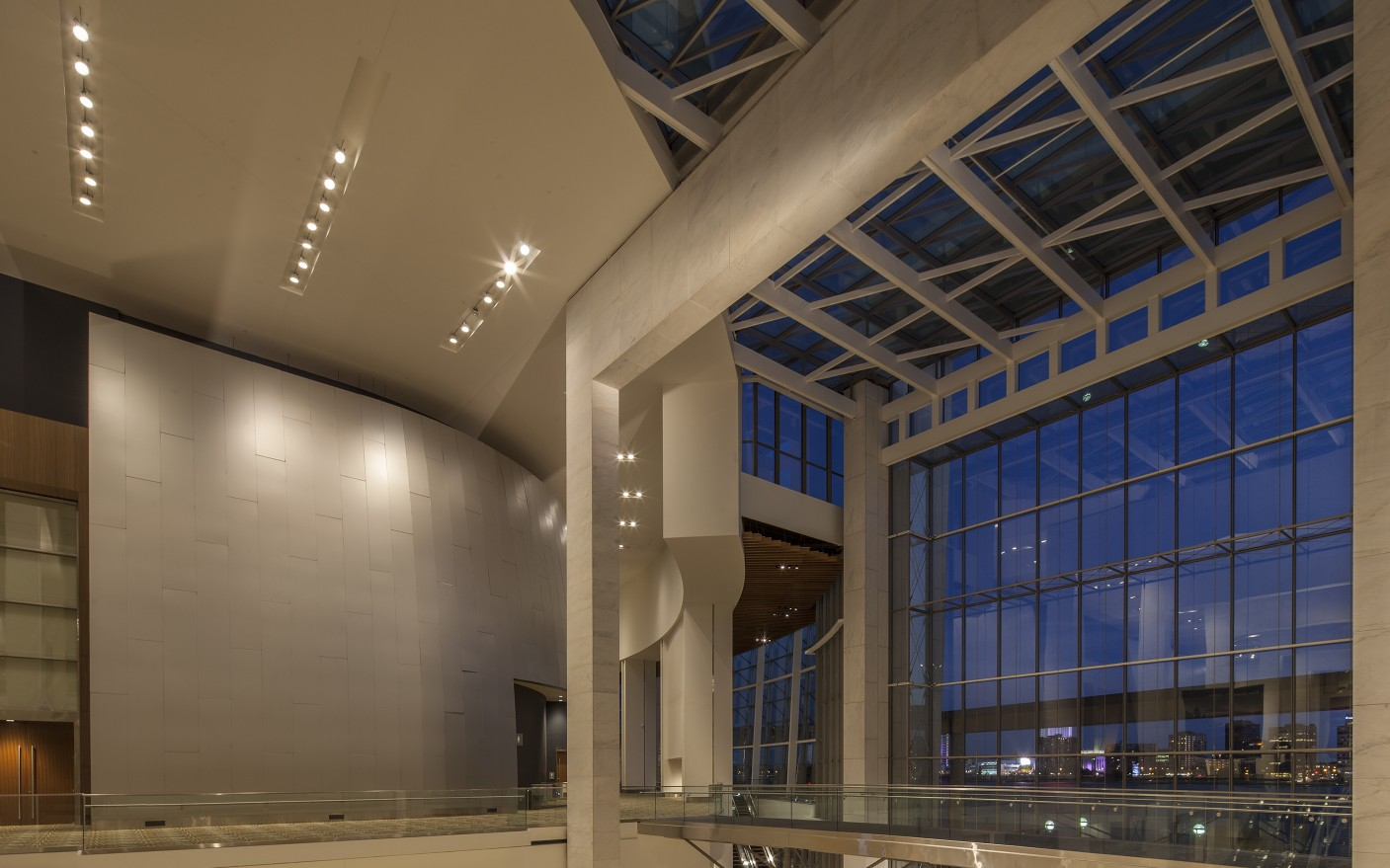 The fixtures are cross-aimed to mimic light coming through the glass atrium during the day.