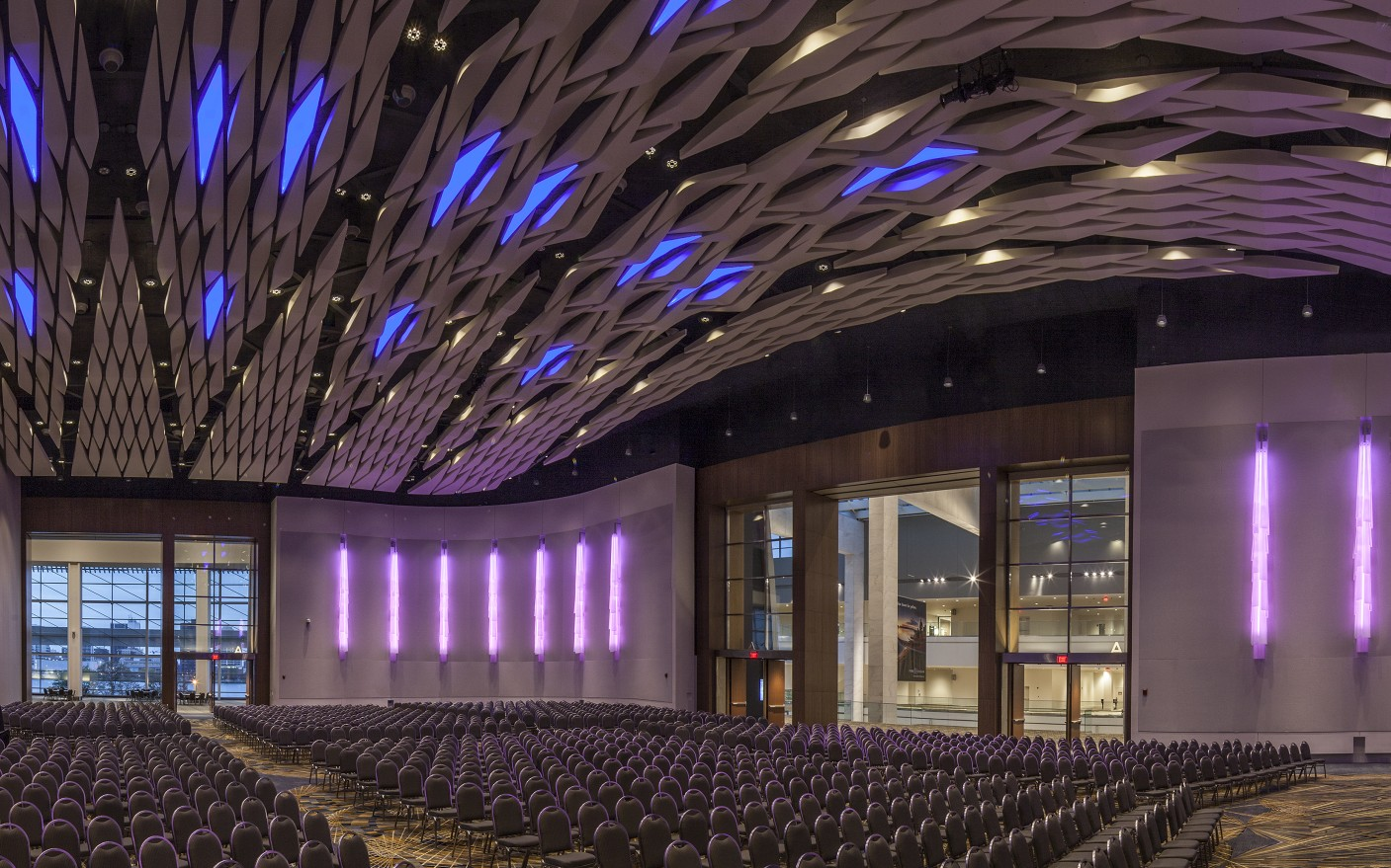 Fully dimmable, the luminaires let the ballroom change the look and feel of the space.
