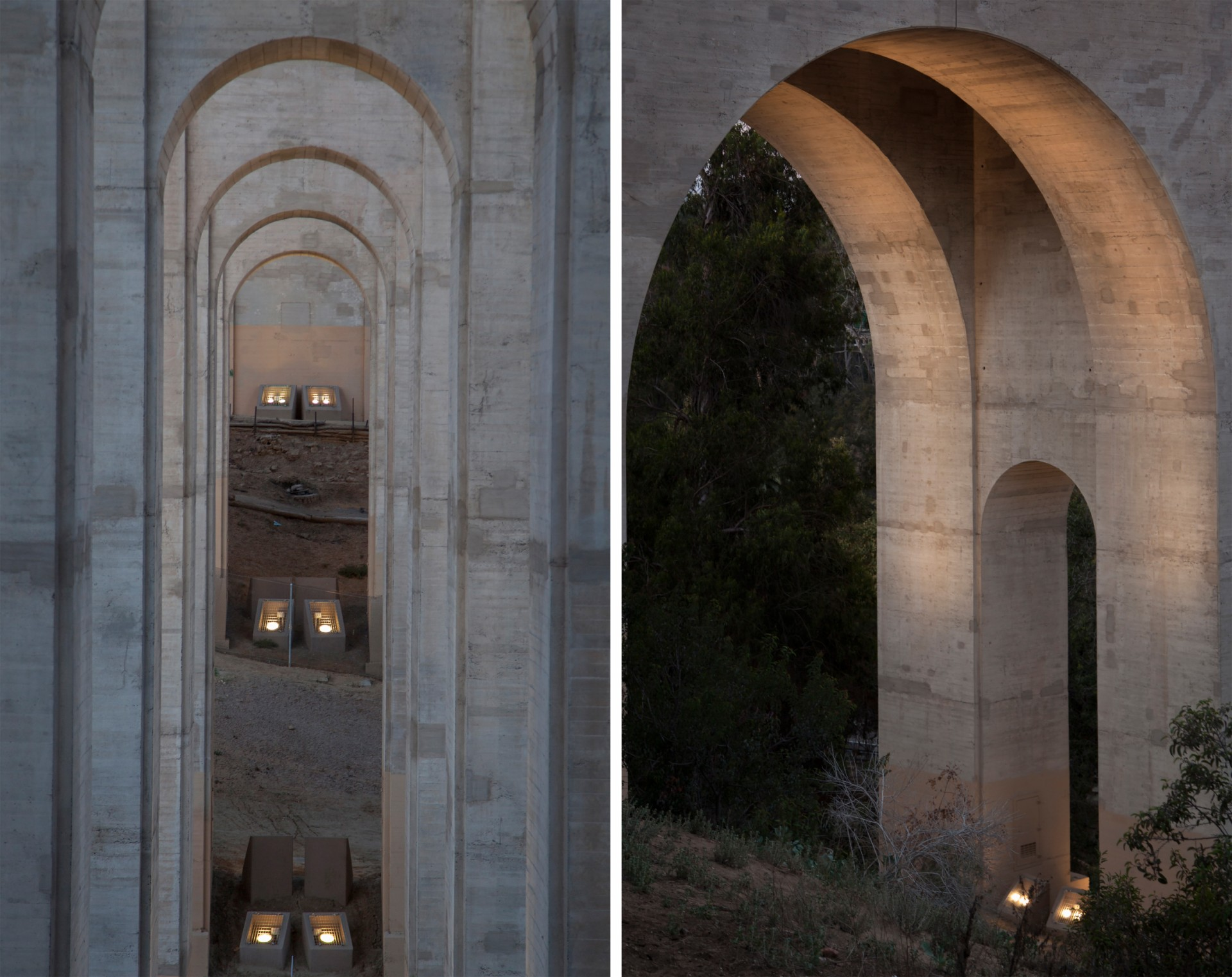 The luminaires are mounted in pairs at the base of each arch.
